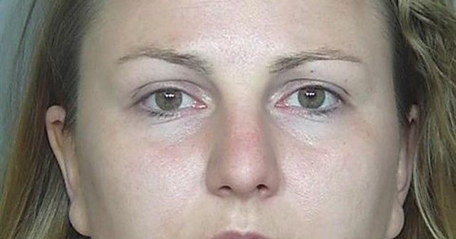 Baby sitter accused of robbing bank to pay back stolen money