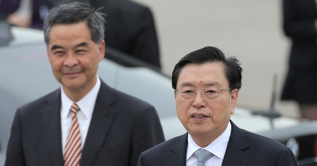 Hong Kong under tight security for Chinese official's visit