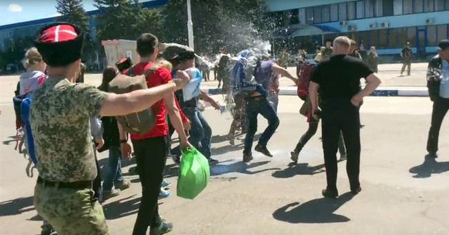 Russian opposition leader, 5 others hurt in Cossack attack