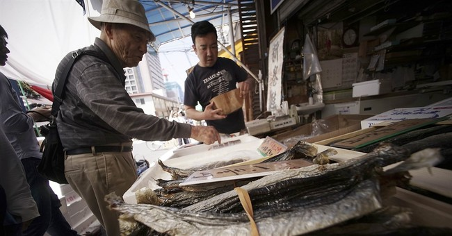 Japan's economy grows faster than expected, but outlook weak