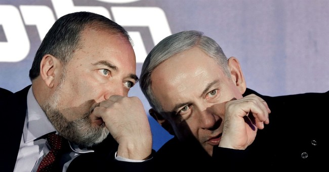 Israel's Netanyahu courts hard-line rival to join coalition