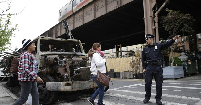 After fire, NYC rail passengers endure overcrowded commutes