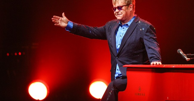 Elton John plays musical tribute to David Bowie in concert