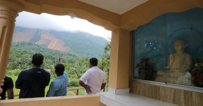 Search resumes in rain for missing in Sri Lankan landslide