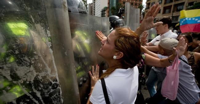 AP Explains: Standoff, dying economy drive Venezuelan crisis