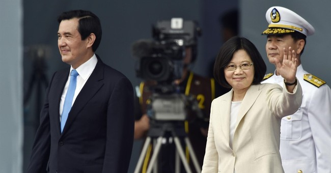 Taiwan installs 1st woman president amid tension with China