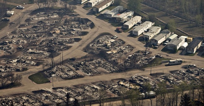 Wildfire raging in Alberta has spread into Saskatchewan