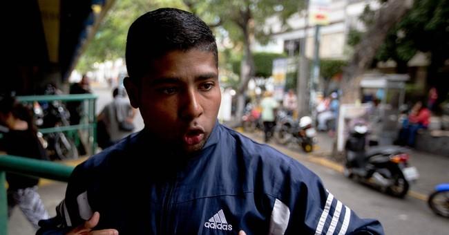 Mob burns Venezuelan man alive over $5 as justice fails