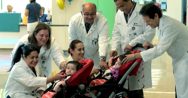 Formerly conjoined twins released from Texas hospital