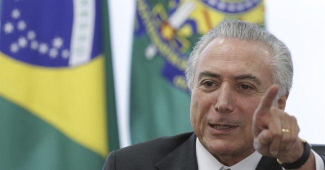 Brazil president vows to fight ouster, but options limited