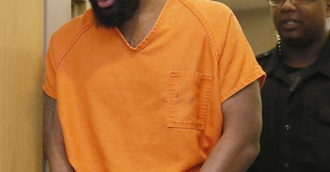 Judge delays decision on beheading suspect's plea request