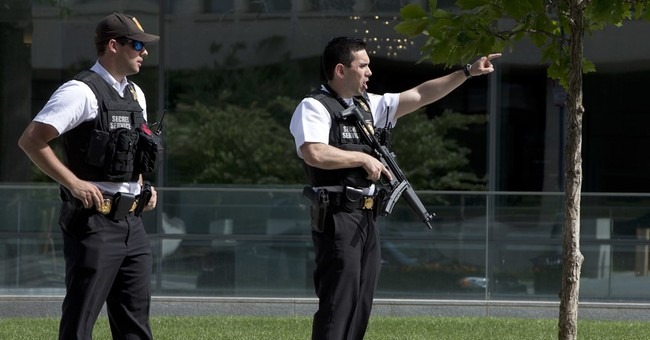The Latest: Secret Service says it shot man with firearm