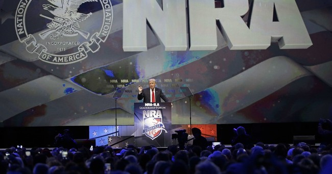 At NRA, Trump slams Clinton for 'heartless' gun restrictions
