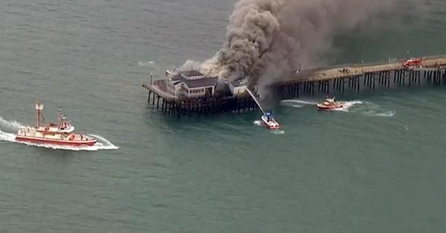 Flames tear through former restaurant on California pier