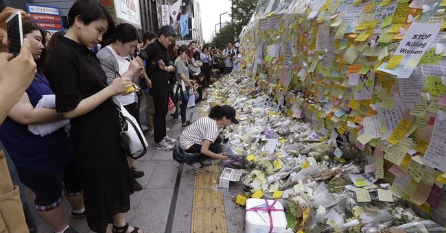 South Koreans march to protest woman's stabbing death