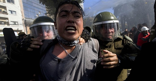 1 dead in Chile protests as president speaks in congress