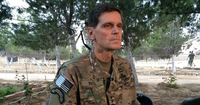 Top US commander makes secret visit to Syria