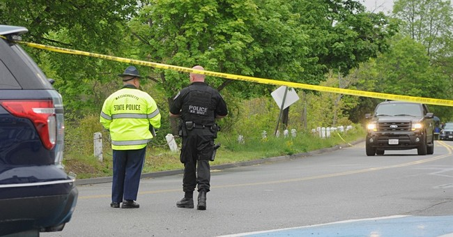 Suspect in Massachusetts officer's slaying dies in shootout