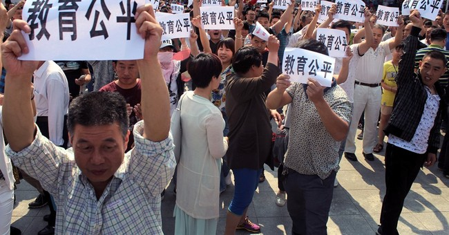 Hundreds in central China protest lack of college placements