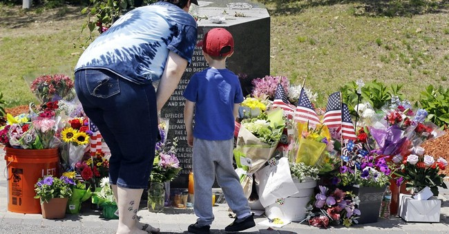 The Latest: Police say slain officer was dedicated, caring