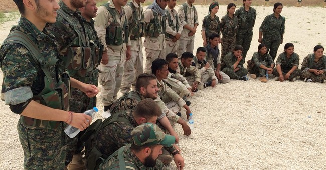 US orders troops in Syria to remove Kurdish insignia