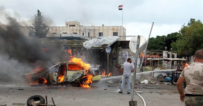 Scores killed as IS bombs hit Syrian government strongholds