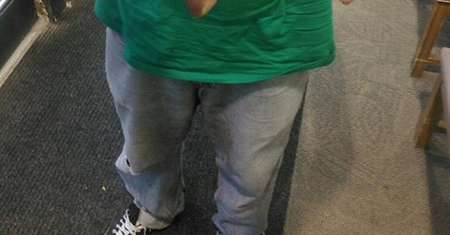 Police smile at 'Cops Suck' tattoo across man's knuckles
