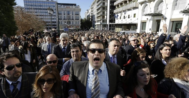 Dressed to Protest: Greek anger spreads to middle class