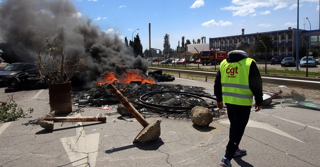 French police force open fuel depot amid protests, shortages