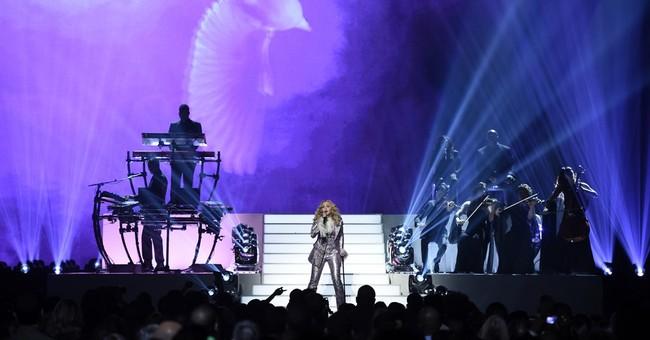 Madonna honors Prince, Dion inspires at Billboard Awards