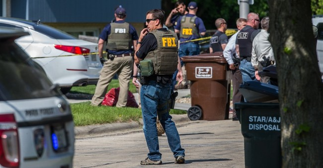 Man found dead where FBI agents shot identified as parolee
