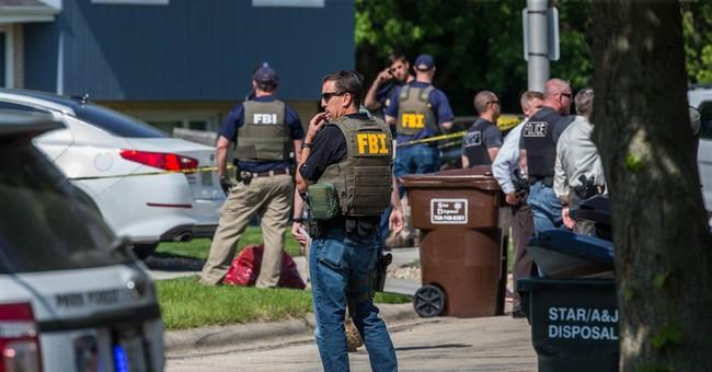 Man found dead where FBI agents shot identified as parolee
