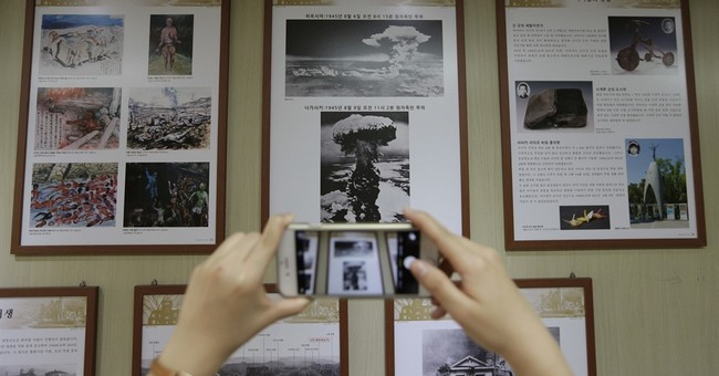 Obama's Hiroshima trip parachutes him into history disputes