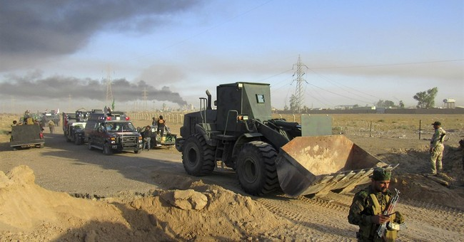 Iraq says clashes with IS outside Fallujah briefly subside
