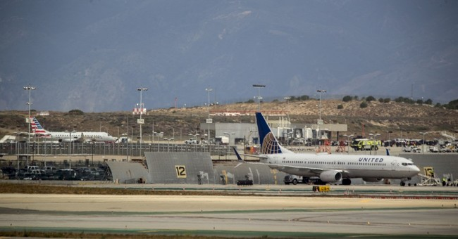 Jet searched as precaution at LAX over 'non-credible' threat