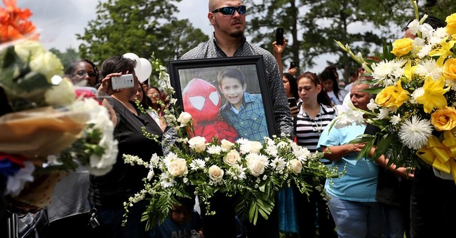 About 500 attend funeral for slain 11-year-old Houston boy