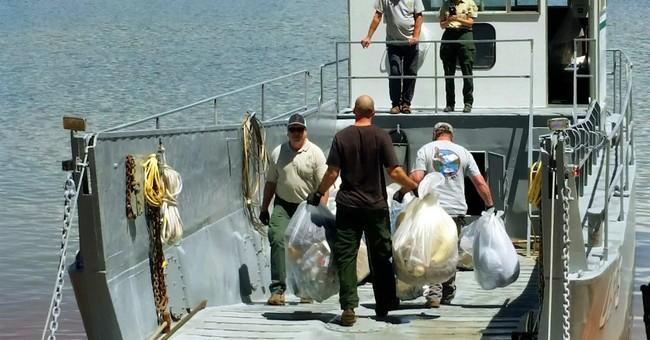 The Latest: University investigating mess at California lake