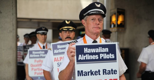 Hawaiian Airlines pilots picket, say contract talks slowed