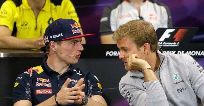 Rivals Hamilton and Rosberg at peace despite crash in Spain