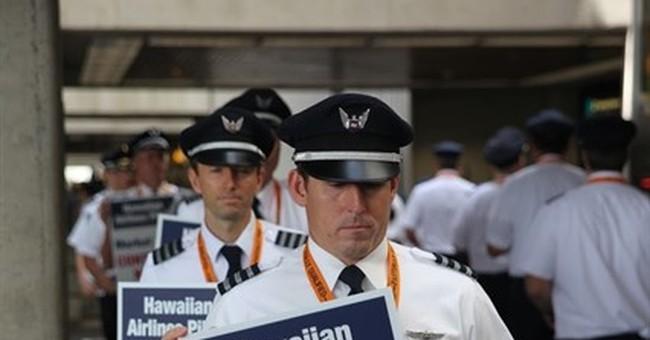 Hawaiian Airlines pilots picket, say contract talks slowed