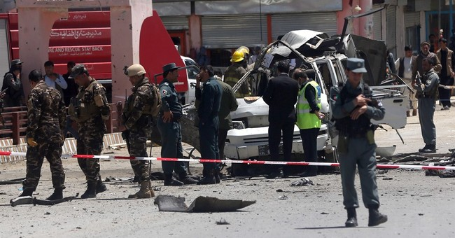 Taliban bomber hits court minibus in Kabul, killing 11
