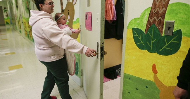 Babies behind bars: Should moms do time with their newborns?
