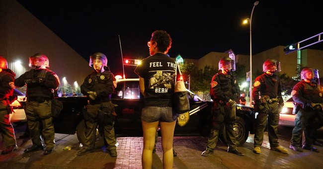 The Latest: 4 arrested amid protests at Trump rally