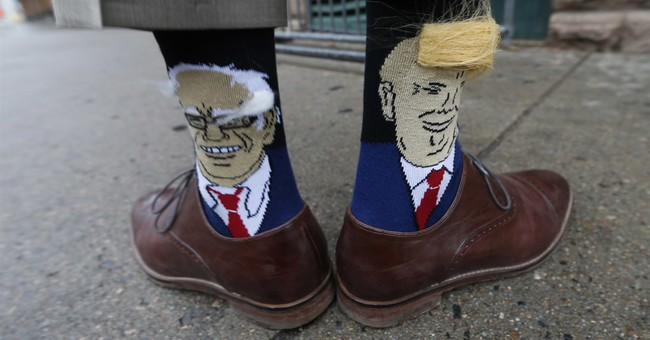 Colorado governor attends event wearing Trump, Sanders socks