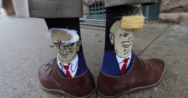 Colorado governor attends event wearing Trump, Sanders socks