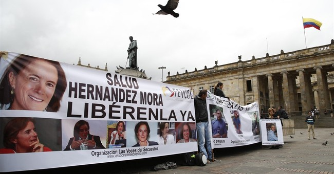 Colombia blames rebels for disappearance of journalists