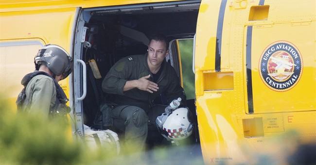 The Latest: Fishermen helped save pilots after jets crashed