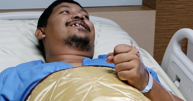 Thai man bloodied but unbowed after intimate attack by snake