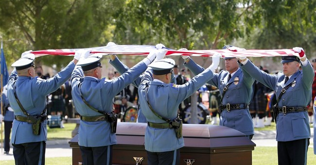 Slain Phoenix officer remembered as 'larger than life'