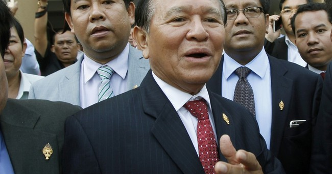 Cambodian police hunt for opposition leader, waylay his car